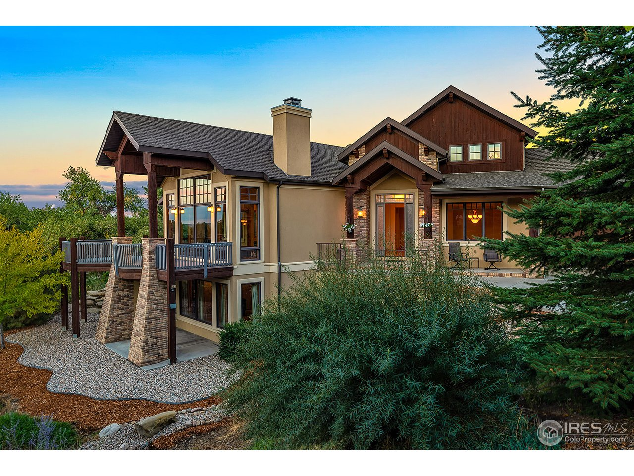 Perfect Location walking distance to top-rated schools. Gleaming solid hickory wood floors, quiet street, spectacular custom kitchen and cherry cabinets, granite counter tops, stainless appliances, and tons of storage. Beautiful decks with river and lake views, access to the Poudre Trail. Walkout basement, designer paint. There is room for everyone in this custom home.