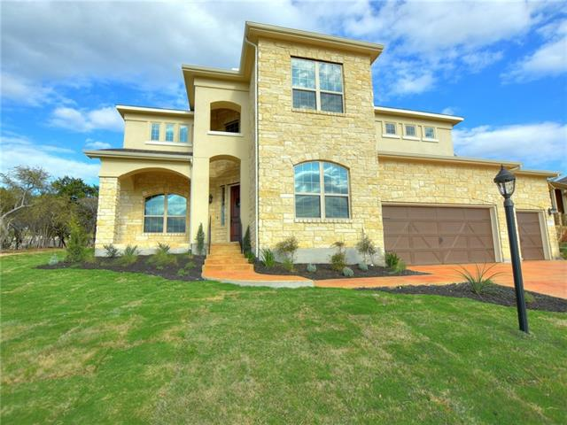 This beautiful home features an open gourmet kitchen and a grand living area with soaring ceilings. The luxurious owner's retreat includes a large tub, double vanities and a spacious walk-in closet, and the spacious secondary bedrooms offer plenty of space for family and guests. The incredible Hill Country and lake views make this home a must-see.