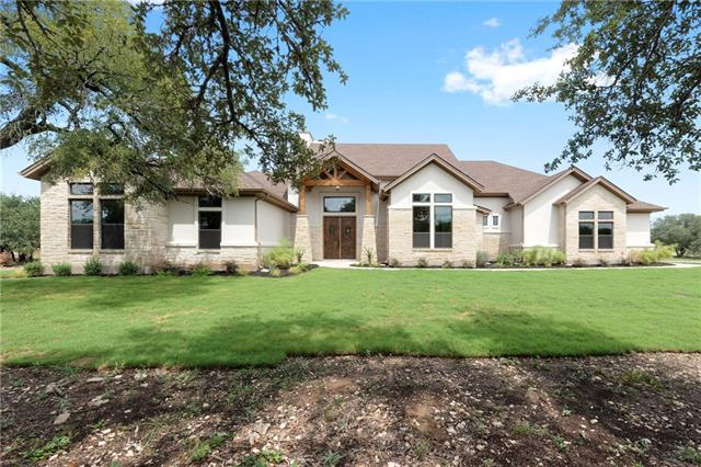 Gorgeous home on 2 acres w/ lots of trees! This elegant home features all the rooms & upgrades you are looking for in Liberty Hill ISD. Gourmet kitchen w/ 2 island that open up into the family room that features soaring ceilings, built-ins & a stone fireplace. 4 bedrooms, study/5th bedroom, 4 full baths and bonus room up stairs. Texas sized 4 CAR GARAGE!!!! Large covered patio w/ outdoor kitchen & fireplace to enjoy entertaining family & friends. This is a must see, come enjoy the Hill Country!