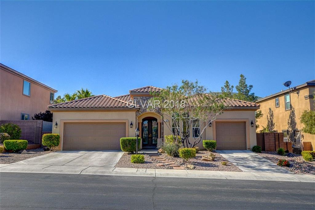 SPECTACULAR SINGLE STORY POOL HOME W/3 CAR GARAGE IN HIGHLY SOUGHT AFTER SUNRIDGE NEIGHBORHOOD IN HENDERSON!IMPECCABLE OPEN FLOORPLAN W/TWO-TONE-PAINT, STONE MEDALLION ENTRY, TILE THROUGHOUT MAIN LIVING AREAS.CEILING FANS & UPGRADED LIGHT FIXTURES. KITCHEN W/ LRG. ISLAND, GRANITE,DBL OVENS, BREAKFAST BAR & KITCHEN NOOK. SPACIOUS MSTR. W/ PLANTATION SHUTTERS, MASTER BA W/ DUAL VANITIES & SEP TUB/SHOWER. PERFECT BACKYARD W/ POOL & PATIO!