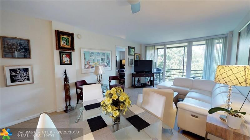 2 bedroom, 2 bath condo with private canal and park views. Tile floors in living areas and baths, carpet in bedrooms. Kitchen has white cabinetry, granite countertops, and stainless steel appliances. Kitchen has been opened to the dining area, with room for counter stools. Hurricane impact windows throughout. 975 square feet of living space. Royal Park has 3 heated pools, mens' & womens' gyms-saunaus-steamrooms, and is pet friendly. Minutes to Wilton Manors, downtown, beaches and highways.