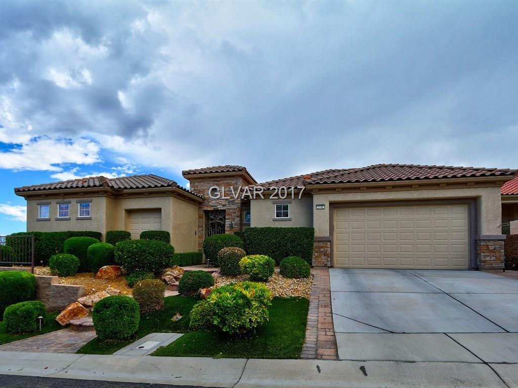 HIGHLY DESIRABLE TRENTON MODEL ON A PREMIUM CORNER LOT W/ SECURED COURTYARD ENTRY. EXCEPTIONALLY UPGRADED & FRESHLY PAINTED HOME INCLUDES 2 MASTER SUITES, CASITA + DEN, MTN/STRIP VIEWS & 2 CAR + GOLF CART GARAGE. OPEN FLR PLAN W/ 10' CEILINGS, GRANITE COUNTER TOPS, MAPLE CABINETS & LIGHTING, SS APPLIANCES, BKFST NOOK, FMLY RM & WET BAR. HUGE MASTER SUITE W/SITTING AREA & WALK-IN CLOSET.  PRIVATE SALT WATER POOL/SPA & WATERFALL. MIN FR REC CENTER!