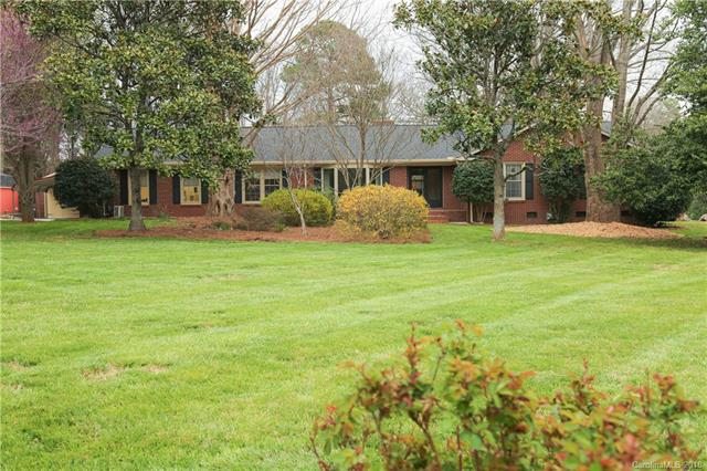 Beautiful 4 bedroom all Brick Ranch situated on 1.4 acres in Farmwood near Pine Lake Country Club!  Level Lot with beautiful trees!  House has been updated throughout and ready to move in!  Spacious kitchen, pantry and utility room with sink and cabinets.  In home office with separate entrance and large tool room.  Master suite with walk in shower and closet.  Enclosed patio/sunroom.  Public water and sewer, natural gas logs.  Hardwood floors, tile and carpet.  Separate detached building, ideal for a possible conversion to an in-law suite, a separate office, or conversion to a 2 car garage.  A gazebo, natural bird area and 3 utility storage buildings, also offers more storage, all furnished with electric.   Buyer's agent to verify schools.