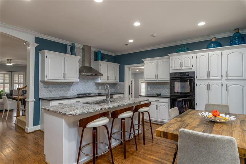 Very spacious kitchen has plenty of seating for a large family or entertaining guests!