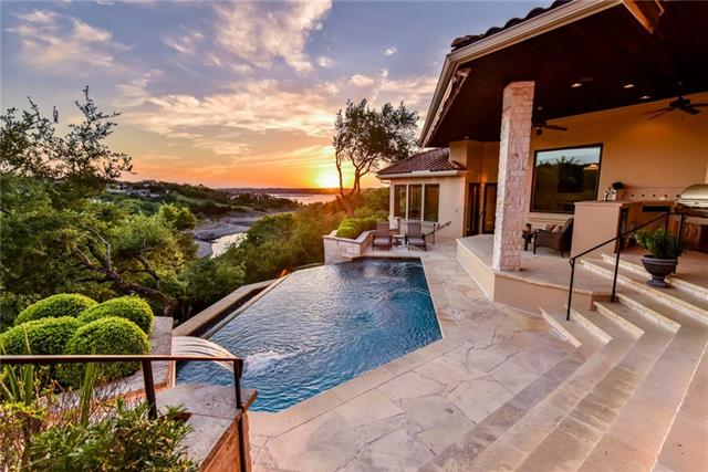 Amazing Estate not only has Hill Country and Lake Views, but its own private covered boat slip in the Vineyard Bay Marina with access to Lake Travis. If you are a sports fan, you will love the media room with built in cabinetry that holds 5 TV's. The Creston system operates the indoor and outdoor entertainment and light controls. Gourmet kitchen with 2 dishwashers, Wolf 6 burner stove, subzero fridge, 2 Miele dishwashers, built in coffee maker & 3 sinks. Negative edge pool with full backyard entertaining.
