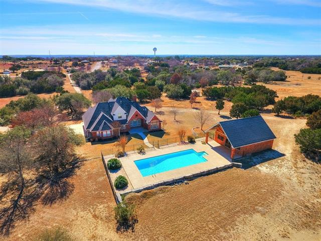 Beautiful spacious home on 18+ acres in city limits of Lampasas! Conveniently near N Key Ave & W North Ave. Amazing private estate that is turn key ready! Open floor plan, butler's pantry flowing through to the dining area. High ceilings in the family room that lead out to a covered patio, pool and a pool house. The 15 acres behind is fully fenced for livestock and is within the county limits allowing hunting..Bonus outbuilding with electricity for storage or workshop. No deed restrictions on the acreage!