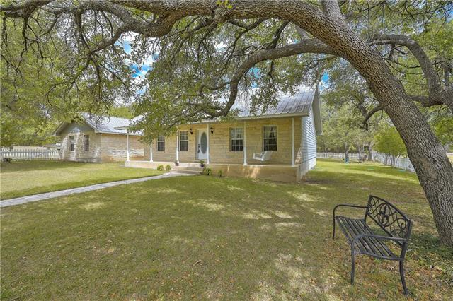 Enjoy peaceful country cottage living!  This Texas ranchette sits on five wooded acres with access to acclaimed Liberty Hill schools and sought after hill country land.  This three bedroom, two bathroom home has two living areas as the finished garage space adds more than four hundred square feet of living space that is not included in the listed square footage. The eat in kitchen is designed for cozy dinners and the office gives you a quiet space to escape or extra space for a fourth bedroom.