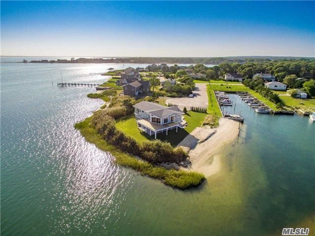 One Of The Hampton's Most Unique Waterfront Smart Homes With Exquisite Views Of Shinnecock Bay, Dune Road & The Ponquogue Bride.  Your Own Private Beach On Wells Creek And Boat Slip Located Right Outside Your Door.  Upgraded On Both The Interior & Exterior With Covered Outdoor Lounge Area And Elevated Deck With Glass Railings Giving Unobstructed Water Views.