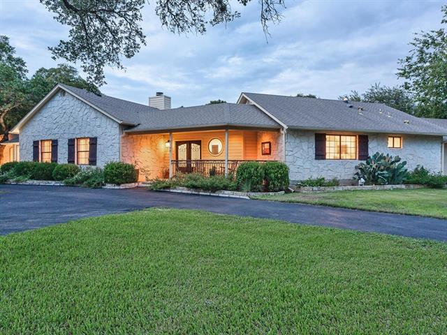 Wonderful Texas style home built for entertaining. From the cook's kitchen w/ high end appliances including an induction cooktop, ice maker, & two pantries, to the enormous great room w/ a wet bar that has two refrigerators, there's plenty of room for family & friends. A screened porch, limestone patio & outdoor kitchen are  on the almost one acre oak treed lot.  Owners will love the privacy of a master on one side of the home and remaining bedrooms on the opposite side. Walk to Ski Shores Marina.