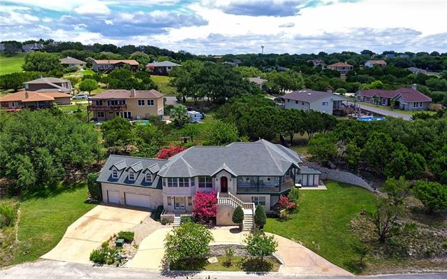 Estate home offering 4 bedrooms, 4 1/2 baths (1/2 is outside of main house ready to service an addition of a pool), 4209 sq.ft.,  3 Car garage and huge storage options, views of Lake Travis off balcony. Unusual combination of 3 res. lots(replatted) create the 0.7/ac on which this house sits. Bonus room perfect for optional uses.  Home does need updating, perfect weekend projects for the go getter.