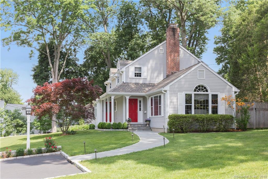 In-town treasure on a desirable cul-de-sac...Beautifully designed by new Canaan architect James Schettino. Light,bright white kitchen opens into spacious family room w/cathedral ceiling, fireplace & custom built-ins.Dining room offers new french doors leading out to slate patio. Living room has fireplace & custom bookcase. First floor master w/vaulted ceilings, walk-in closet, large bath and french door to patio. Featuring five 9ft windows, East/West exposures & finished LL designed for media room w/full bath. Exterior enhancements include large slate patio, bluestone walkways, porch & steps, landscape lighting & plants,stonewalls & newer driveway all completed in 2016. Walk to town, train,schools & parks. A must see.