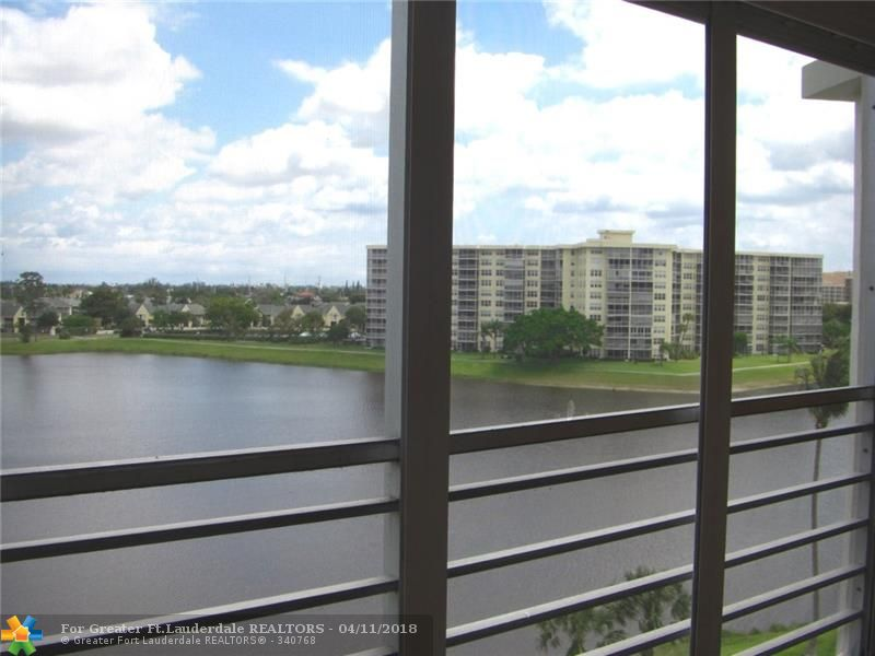 Light filled spacious 2 bedroom 2 bath condo with beautiful water view. Both bedrooms have en suite baths.  Freshly painted, newer laminate flooring. Heated pool, fitness center, assigned parking, secure lobby. Can rent after one year. Priced to sell. Seller to give Buyer credit for new flooring in bedroom.