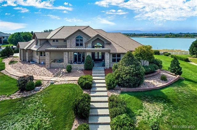 Exceptional custom home on McKay Lake offering year round, uninterrupted lake & mountain views from almost every room! 9,300sf of comfortably appointed space, this 5 bed, 6 bath home graciously greets all. Main level highlights gourmet kitchen boasting granite counter tops, island, butler's pantry & custom cabinetry, cozy breakfast wet bar with fireplace & luxurious master retreat w/ fireplace & view sure to please. Upper level loft & balcony area & bedrooms each w/ private en-suites. Private gym, game room, huge 6-car attached garage. Walkout lower level is 40% finished with tons more storage space or future expansion. McKay Lake has a walking trail around the entire lake and is stocked with fish. Can be used for paddle boarding or any non-motorized water craft. Great shopping at Orchards, extremely convenient location.