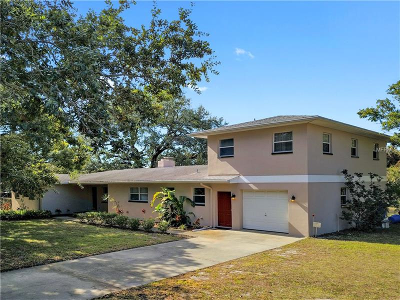 Rare opportunity in the area of Belcher and Harn roads in Clearwater. This large home with a above garage efficiency sits on 4.75 acres with a 3/4 acre pond at the rear. Pond is believed to be spring fed and leads to Allen's Creek. Home is in good condition. Large kitchen, beautiful wood floors in most living areas. All bedrooms are very large. Split floor plan. Spacious indoor laundry room. Light and bright sunroom/bonus room at back of house great for home office. Separate dining room, and lots of eat in space at the kitchen island. Walking distance to Oak Grove Middle. Currently zoned R3, but possible to explore other options with the county. Move right in, redevelop, or a combination thereof.