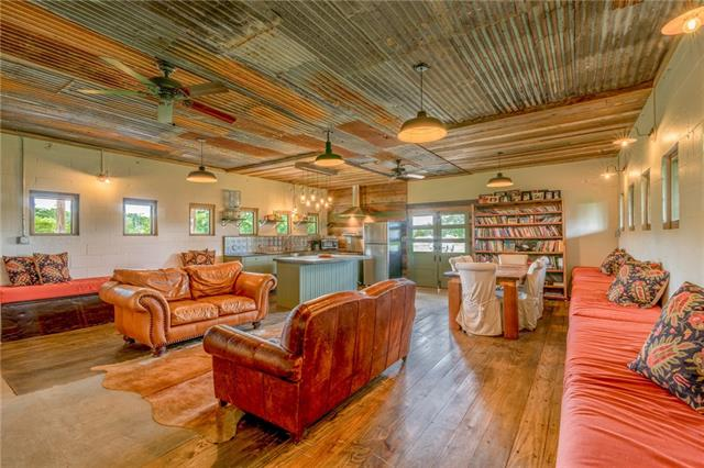 Blanco River Farms is a dream in the Tx Wine Country! With 13+ acres situated across the Blanco River this unique & renovated dairy barn has endless possibilities. Once a BnB because of it's proximity to Tx wineries, Real Ale Brewery and only 1 hour from Atx, San Antonio & Fredbrg is For Sale! Here's your chance to own a piece of the Tx Hill Country!Features include solar panels, commercial stove, 200G & 1000G propane tank,  H2O strg tank, barn Bunk house, furniture included w/ acceptable offer. Ag Exempt