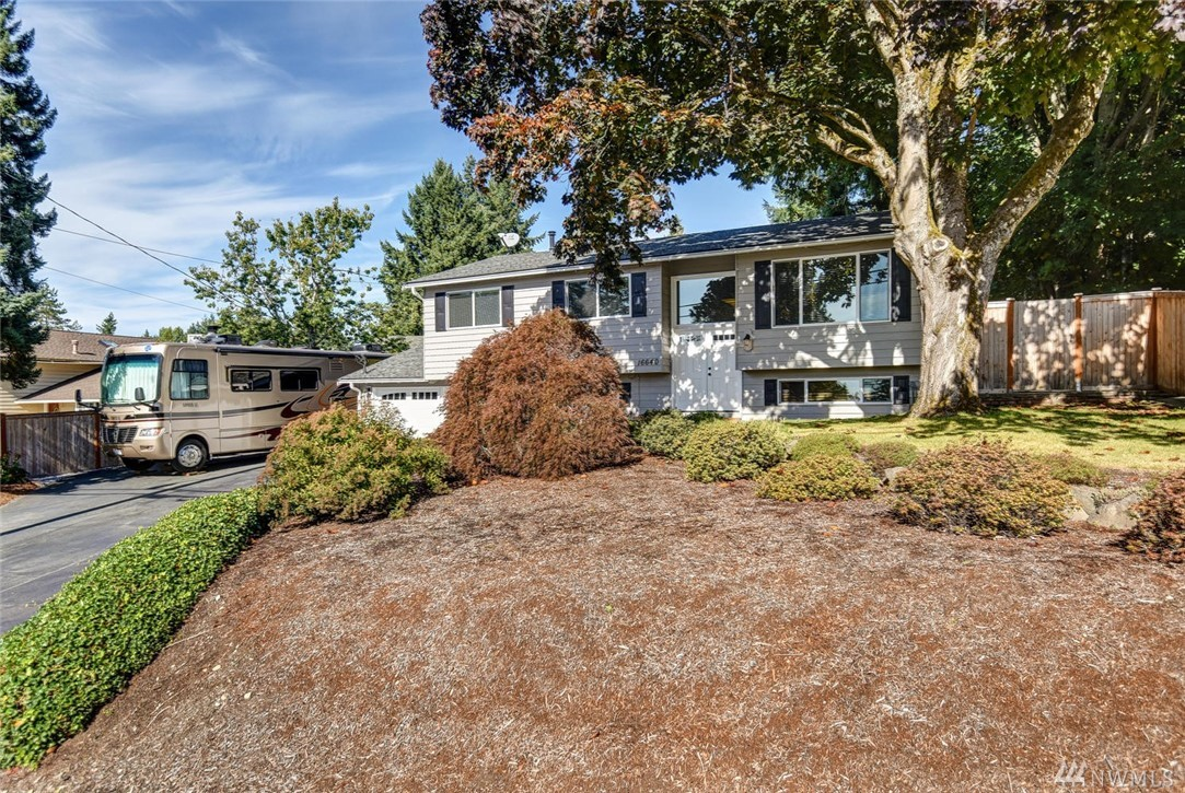 Well cared for Education Hill Home, lovely view of Redmond city lights, 4 beds (3 on main floor & 1 lower level); new 2.5 baths (2 on main level & 1/2 on lower level); fabulous family room/media on lower level w/ wet bar & 'warm' gas insert fireplace; 2 car gar; spacious deck w/ 2 gazebos; fenced yard, & RV parking, walk to town, schools, bus station. Pre-inspected !              NEW: front door, fence, water heater, gar doors, baths, A/C, paint, & many more (see flyer in home); 3-year-old roof.