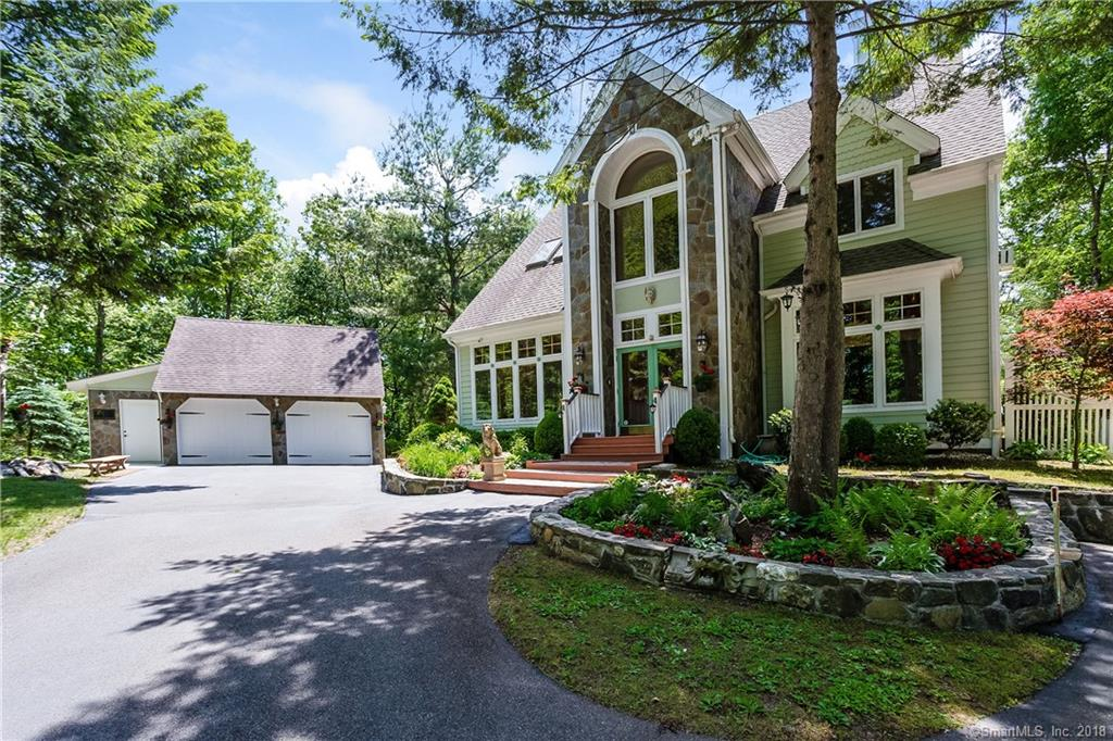 A one of a kind, magnificently built craftsman Post & Beam style home sited on 2 plus private acres in Brookfield CT.  The home is nestled back from the street with stone formations providing privacy from neighboring homes.  Spacious open floorplan has a finished loft and room in the basement for almost 3000 sq ft.  As you enter the impressive foyer you are captivated by the impeccable attention to detail.  Exposed beams, cathedral ceilings, millwork, solid wood doors and 2 rustic fireplaces.  Exceptional light with over-sized windows & skylights. A gourmet style kitchen with a granite center island, solid Cherry cabinets, and built-ins opens to the dining room w/ sliders to the expansive tiered deck perfect for entertaining overlooking the private backyard w/ extensive landscaping and stone walls. Work from home in the spectacular main level office or make it a formal sitting room.  Upstairs offers 3 spacious bedrooms all with hardwood floors and generous closet space, one has a private loft perfect for a fitness area and separate storage room.  The wonderful Master Suite has an open reading nook, soaring ceilings, a full bath with a tiled walk-in shower and plenty of natural light.   Lower level has a finished space perfect for a guest or rec-room.  Also available turnkey with all furnishings.  Additional space in the massive detached garage with extra storage above and an attached shed for all your gardening tools.  Nothing to do but move in and enjoy vacationing at home!
