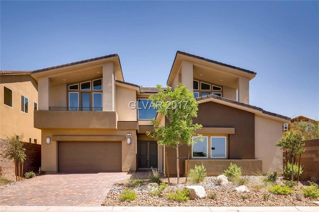 Beautifully appointed William Lyon Home in the resort style living of Lake Las Vegas.  This home features updated flooring and carpet, 2 decks at bedrooms 2 and 3, private bed and bath downstairs, covered patio and a 4 car garage.