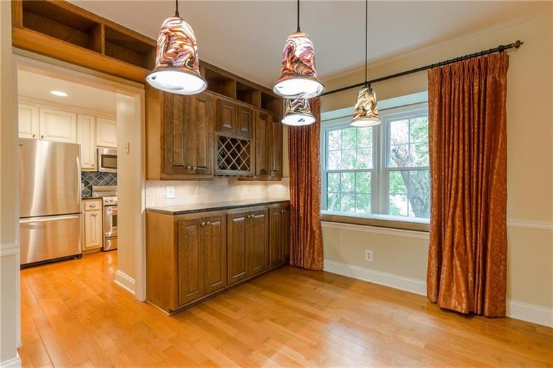 Renovated, spacious unit in a wonderful, gated community with swim, tennis, golf & more! This top-floor unit has been meticulously maintained & features an open floor-plan with dining room, living room PLUS a large sunroom/den, all with hardwood floors. The dining room w/ butlers pantry & wine rack. This leads to the kitchen w/ S-S appliances & granite countertops. Master bedroom has multi closets w/ built-ins & bath with frameless glass shower. Beautiful secondary bath w/dble vanities. 24-hour guard. Washer/Dryer in unit. Add $45/mo towards HOA, water,trash= $1643/mo