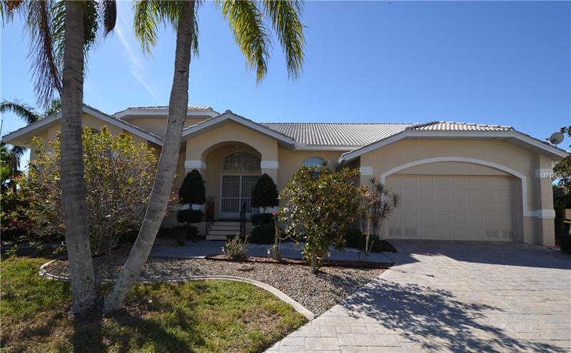 PGI! DIRECT SAILBOAT  ACCESS VIA PONCE INLET TO CHARLOTTE HARBOR! 176' WATERFRONT ON OVERSIZED TIP LOT WITH 2 DOCKS & 10,000 LB BOAT LIFT!  3 BD/2.5 BA + DEN POOL HOME. Open floor plan with 2,725 sq. ft. of living area. Cathedral ceilings, transom windows and tile throughout main living area. Formal living room with pocket slider access to lanai and pool, formal dining room and spacious kitchen with raised panel wood cabinetry, granite, stainless appliances, large center island, walk-in pantry, built-in desk and breakfast bar. Breakfast nook and spacious family room off  kitchen. Master bedroom features sitting area, private access to lanai, patio leading to dock, 2 large walk-in closets and private master bath with dual vanities, jetted garden tub and walk-in shower. Covered lanai with summer kitchen for entertaining and convenient half pool bath. Screened solar heated pool with brick paver decking and amazing water views. Every room has a water view! For an additional price, owner will also consider selling as a full package with boat and furnishings(some exclusions apply). Call agent for package details and additional pricing.  CALL TODAY!<Red><Big><B> For Free Recorded Info 24/7 Call 1-800-327-6040 Ext 608 </Red></B></Big>