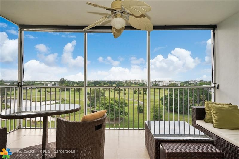 ABSOLUTELY GORGEOUS, JUST SIT ON YOUR BALCONY AND ENJOY THIS STUNNING VIEW OF THE GOLF AND SUNSET.  WOOD FLOOR TROUGHOUT. THIS CORNER UNIT HAS BEEN TOTALLY REDONE WITH HURRICANE WINDOWS AND ALL REQUIRED PERMITS.  THE CONDO IS BEING SOLD WITH ALL THE FURNITURE. JUST LOOK AT THE PHOTOS AND YOU WILL FALL IN LOVE WITH IT. CLOSE TO SHOPPING, RESTAURANT, CASINO AND MUCH MORE.  THIS IS A MUST SEE.
