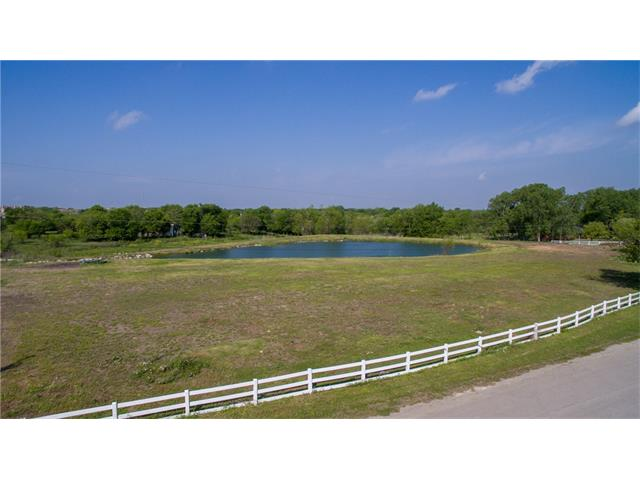 3.782 Acr. Prime Ranchette Location in Heart of Round Rock!Sub dividable lots all build- able zone X  lots !Modifications incl. prof. added drainage,Elevation changes, for Zone X, ,drainage added,creek owner engineered fed 22ft deep pond,creek fed pod,creek along back of property belongs to owner, leveled and cleared acreage.  Rare prime acreage lot in city limits w/City Water, City Sewer taps,Electric & phone available, Equine community.Flood Zone X, Zoned SF2,Verify Horses allowed NO HOA