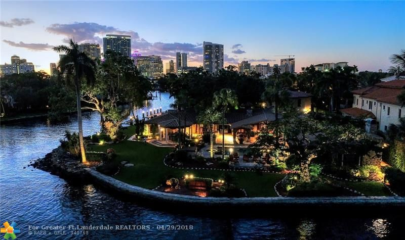 One of the largest (36,518sf/384'deep water) South-East Points!4 major renovations as recent as 2014. Superb private resort style Estate close to Las Olas.Spectacular walled/gated grounds Amazing views.Mainly 1st level living  vaulted ceilings,Chef's kitchen,theatre,wine cellar,club room,2 bars,fireplaces,gym/office,potential 2 incredible private master wings,large bedroom suites,maid's/captains quarters.Large guest house over garage.Gazebo, summer kitchen,superb pool area-unlike any other point offering!