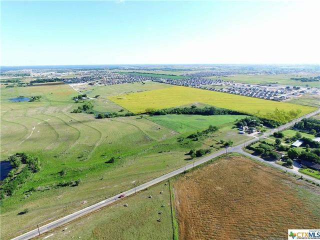 Beautiful ranch close to development in the fast growing town of Jarrell, Tx. Over 675' linear feet of frontage. Large pond. 1300 ft shop. will consider sub-dividing. Jarrell ISD. Quick access to I-35 and more. Another 40+ adjacent acres available. Excellent investment for the future.