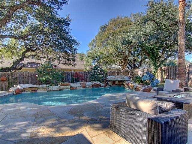Hill Country Community of Lakeway, Texas. Home is a soft contemporary inspired home with a tropical pool in relaxing backyard oasis. This home sits on a cult-de-sac and has 4 bedrooms and 3 bathrooms. The kitchen is open to the 2 store great room which has plenty of space for entertaining. It is a must see.