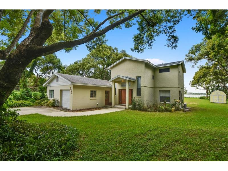 Live like you're on vacation every day! Sip your morning coffee with breath taking views of LAKE FAIRVIEW from almost every room in this CUSTOM WATERFRONT HOME. Nestled on almost an acre with mature trees, spacious 16 X 10 utility storage shed, in a quiet community with **LAKE ACCESS**, LOW HOA, room to add a POOL and just minutes from COLLEGE PARK and downtown.  The living and dining area offers practical use of space and luxurious appeal with tons of room for entertaining inside and out.  Open living space boasts beautiful exposed wood beams, easy care tile and wood flooring all with ample windows that bring the natural beauty in. The Recently Remodeled MASTER RETREAT upstairs features a beautiful lake view, WALK-IN CLOSET, CUSTOM BARN DOORS, GORGEOUS CUSTOM MASTER BATH and outdoor access to create the balcony of your dreams-the perfect place to unwind at the end of the day.  Kick back in glorious solitude right in your own backyard or gather with friends and family for a BBQ.  When work is required, commuting is easy to downtown Orlando along with convenient access to I-4 and 408 Expressway. Luxurious privacy awaits on 1 acre with no rear neighbors. Don't wait! Lakeside living is just a call away.