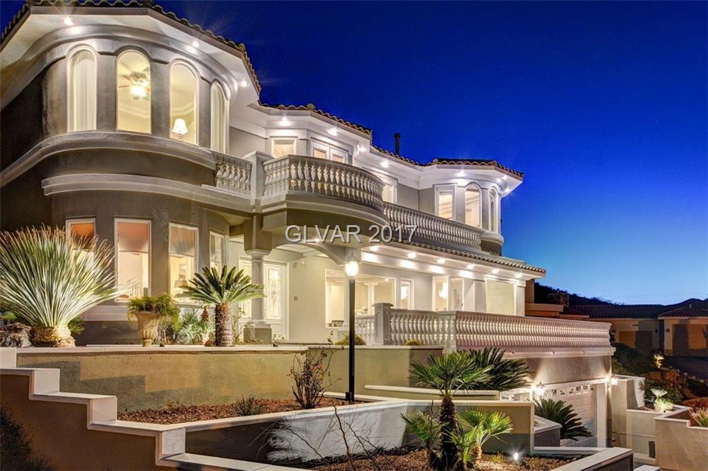 Exquisite, estate w/ stunning architectural details, walls of glass that showcase breathtaking panoramic views of Lake Mead, secluded resort-like pool, spa & private retreats. Beyond the entry discover a flowing floor plan designed for entertaining, superb craftsmanship, formal rooms, an office, library, gourmet kitchen w/ island & walk in  pantry . Master suite is an oasis of comfort. 1,312 sq/ft garage, oversized doors to accommodate your toys!