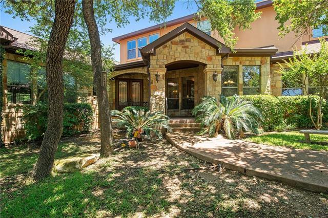 Quality custom 3135 sqft home. Stone and stucco exterior on a quiet street near Serene Hills Elem and Lake Travis High Schools. Enter through a walled gated courtyard covered by beautiful mature oak trees. Master suite and guest room/office downstairs. High ceilings with a gourmet kitchen, gas cooktop, formal dining, large family room and stone fireplace. Granite counters, SS appliances, alder wood cabinets, stained concrete floors. Two large bedrooms and game/living room upstairs. Pool 2015. No HOA