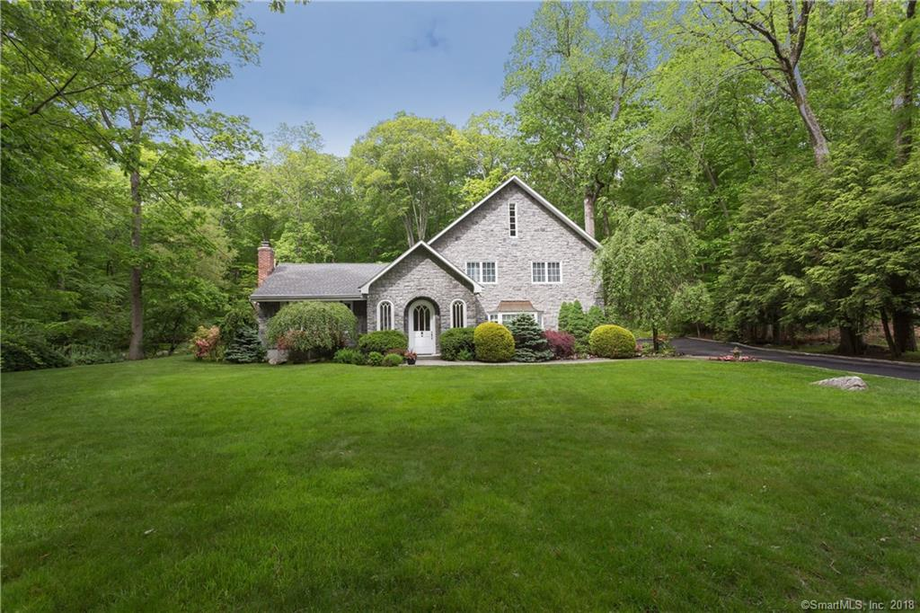 This wonderful one of a kind home is located at the end of a cul de sac, situated on 2 acres and it abuts the 110 acre Mianus River Park. There are 8 skylights that brings in wonderful natural light filling nearly every room with sunshine. There is a wood burning fireplace in the large living room and one in the family gathering room which adjoins the large kitchen with center island. A large family room and a custom office with built-ins complete the first floor. The second floor has a master bedroom and 3 double bedrooms. A spiral staircase allows access to the 3rd floor with a guest room and a computer/exercise room. The rear deck is a perfect place to enjoy alfresco dining and take in all nature has to offer. Just minutes from train, town, parks, schools.