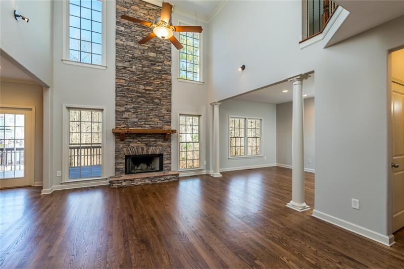Breath-taking floor to ceiling stacked stone fireplace in family/great room!