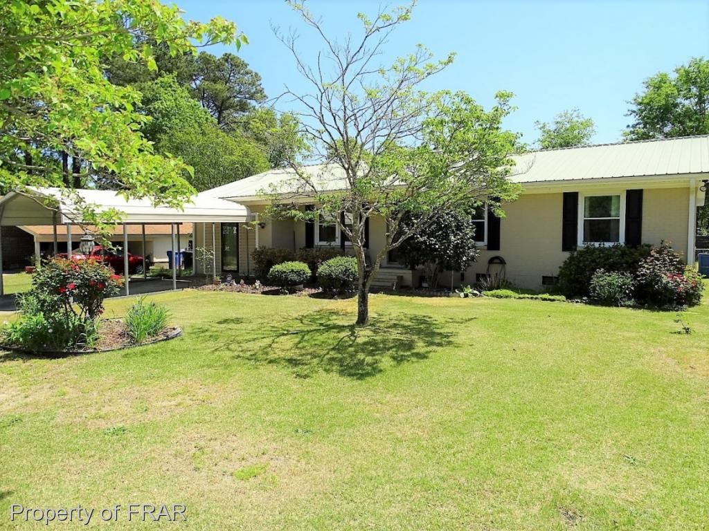 -Beautiful 3 BR ranch in the sought after Jack Britt school district with EIK with breakfast bar,family room, 2 outside storage sheds(1 wired), rear fenced yard with deck and lots of vegetation, and an enclosed garage with laundry room