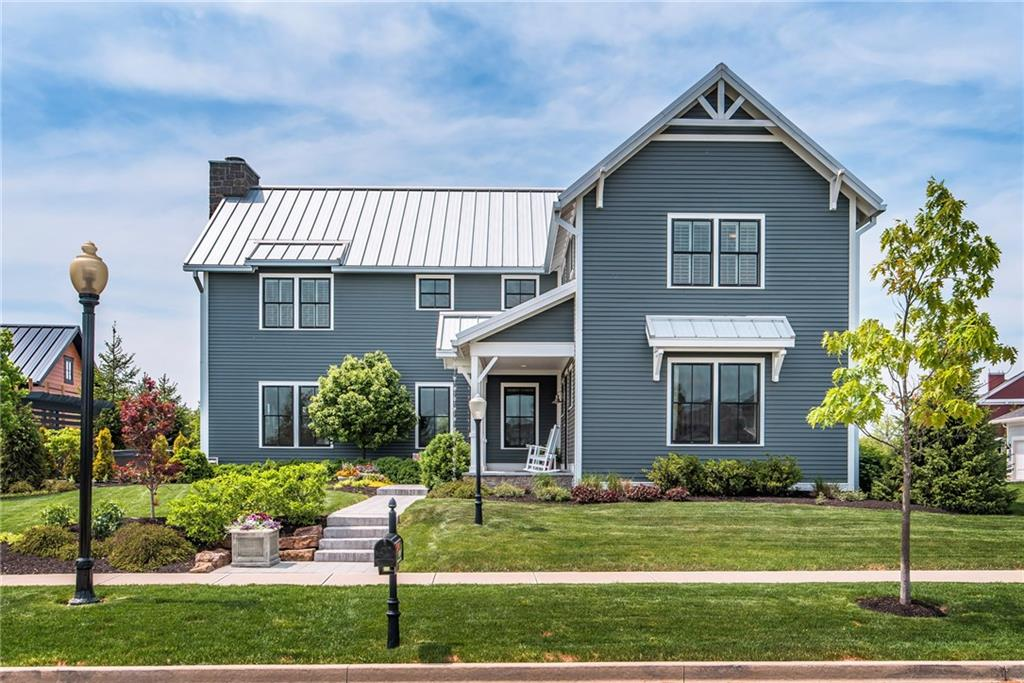 "Stunning modern ""Farmhouse"" in the Village of West Clay!  Part of Home-a-Rama just a few years ago, this Masterpiece doesn't disappoint.  Low maintenance Metal Roof, superb landscape, beautiful/private outdoor living area w/ pergola, & fireplace. Spacious back yard overlooking tree-lined common area.  Inside feels open and airy with loads of natural light.  Open concept living w/ custom cabinets, gourmet kitchen, reclaimed wood beams, butler pantry, & wine bar.  Master Suite is warm and inviting.  Master bath incl. gorgeous walk-in shower, elegant double vanity w/ granite, & custom walk-in closet.  Basement rec room w/ full bar & wine cellar.  5th bdrm, office, & exercise room in highly func'l basement. Come see for yourself - Better Hurry!"