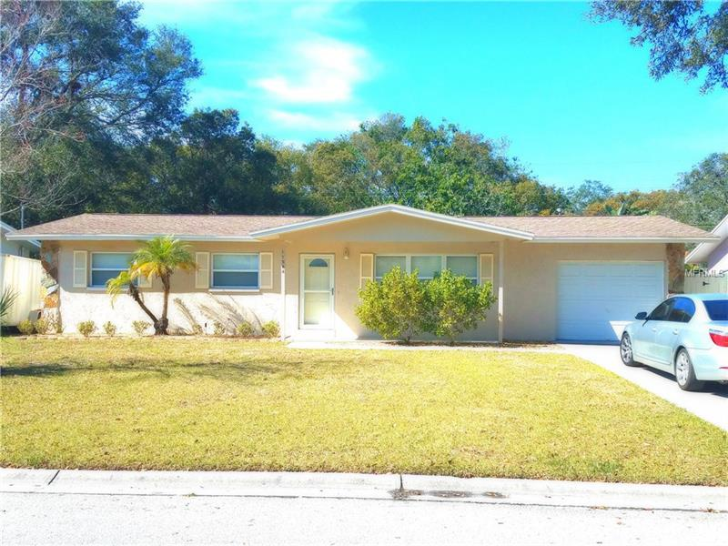 Beautiful spacious home located in a Non Flood zone with a huge fenced  backyard that backs  up onto the Pinellas County Trail .  This home features 3 bedrooms and 2 full baths, large screened Florida Room,  open deck, and a shed in the back yard . Many items have been updated in this home in November of 2015. Home has a new kitchen with granite counter tops, newer appliances, newer paint inside and out, wooden floors, newer tile and a roof that is  only a few years old.  Home is located close to Seminole schools, Walshingham Park and some of the best beaches in the country.  Hurry! This one will not last long!!!