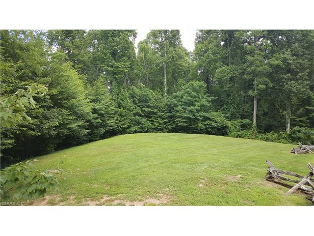 Great 3.8 acre lot in Pathways of the Solomon. Located near downtown Hendersonville and just minutes from 5 local golf courses. Only 1 mile to Champion Hills Country Club. Quiet setting in area of nice homes. Winter views with the possibility of year round views. Water available at the road, will need a septic system.