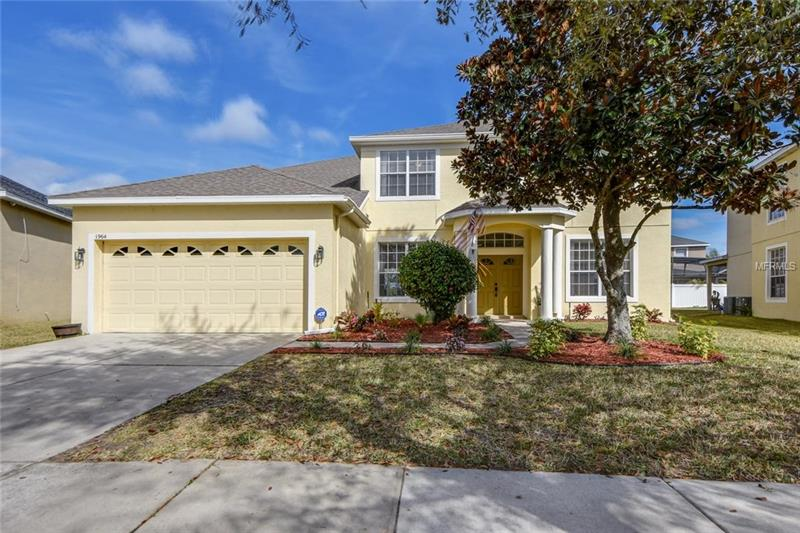 **Now's your chance to live the convenient lifestyle everyone seeks in this beautifully updated 5BD/3BA home** Located in the Cypress Lakes community offering a centralized location with easy access to all Orlando has to offer. Relax in your new, bright open living space with a neutral color palette, easy care tile floors throughout the first floor, and an abundance of windows for natural light to flood in. Large master suite boasts a master bath with dual sinks, garden tub and separate walk-in shower. Spacious secondary bedrooms add to the appeal of this home. The open living area unifies the space so you that you can interact with family or guests easily. **MODERN UPDATES INCLUDE TWO NEW A/C UNITS (2017), NEW TILE FLOORING DOWNSTAIRS (2017), NEW INTERIOR PAINTS (2017), 2 BATHS UPDATE (2017), AND GE ELITE WATER PURIFICATION SYSTEM (2017). The family chef will love the **UPDATED KITCHEN** with **NEW KITCHEN AID APPLIANCES (2017), NEW KITCHEN CABINETS (2017)**, tile backsplash, and breakfast bar. Kitchen overlooks breakfast nook and spacious family room with large sliding doors to access the covered lanai and lush backyard. Cypress Lakes offers a resort-style COMMUNITY POOL, tennis and basketball courts, splash pad, clubhouse with kitchen, fitness center, playground, walking trails, and a dog park. Nearby 408/ East-West Expressway provides an easy commute to the airport, downtown and to many attractions and Theme Parks.