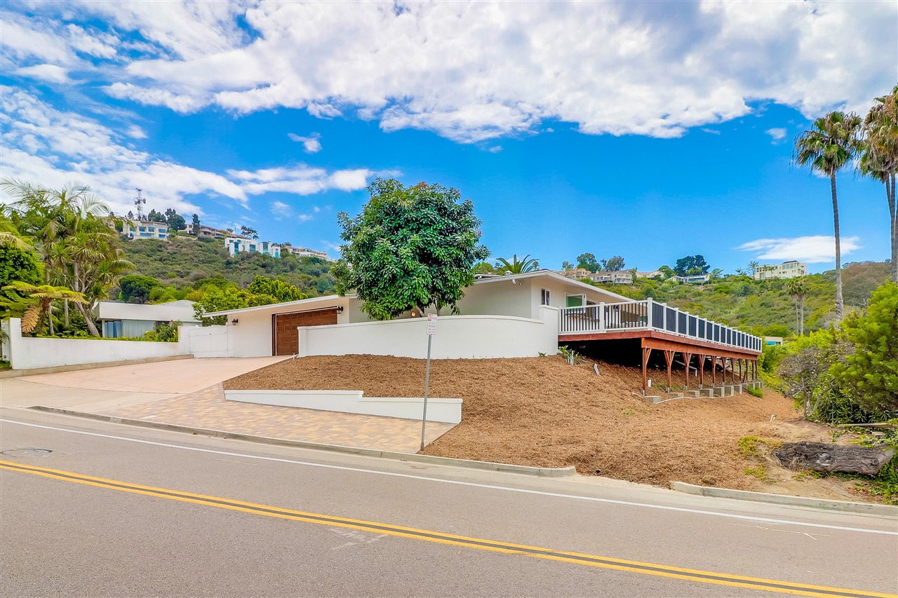 Enjoy old La Jolla with a modern twist. This unique home offers an approx 1500 sq ft Trex deck to enjoy spectacular sunsets overlooking La Jolla Shores and Scripps Pier. Entertain guests on the deck or enjoy the cool saltwater pool accessed through new accordion doors from either side of the living room and dining area. Custom built kitchen has one-of-a-kind kitchen windows for panoramic ocean views and fresh ocean breeze. Brand new kitchen with Wolf range, sub-zero refrigerator, Bosch dishwasher,apron sink, granite counters, and a full walk-in pantry including caterer's fridge. Plantation shutters throughout, pitched ceilings, new epoxy garage floors, new double pane windows, new travertine floors, new pool deck pavers and more! The casita is perfect to use as an office or a separate guest room with its own bathroom. Ring doorbell is also included! Home was completely renovated with more than $400K in upgrades. Approximately another 1000 sq ft, not currently included in sq ft noted, includes a massive Master bedroom suite looking out to the ocean view. Buyer may be able to choose finishings for master bathroom.