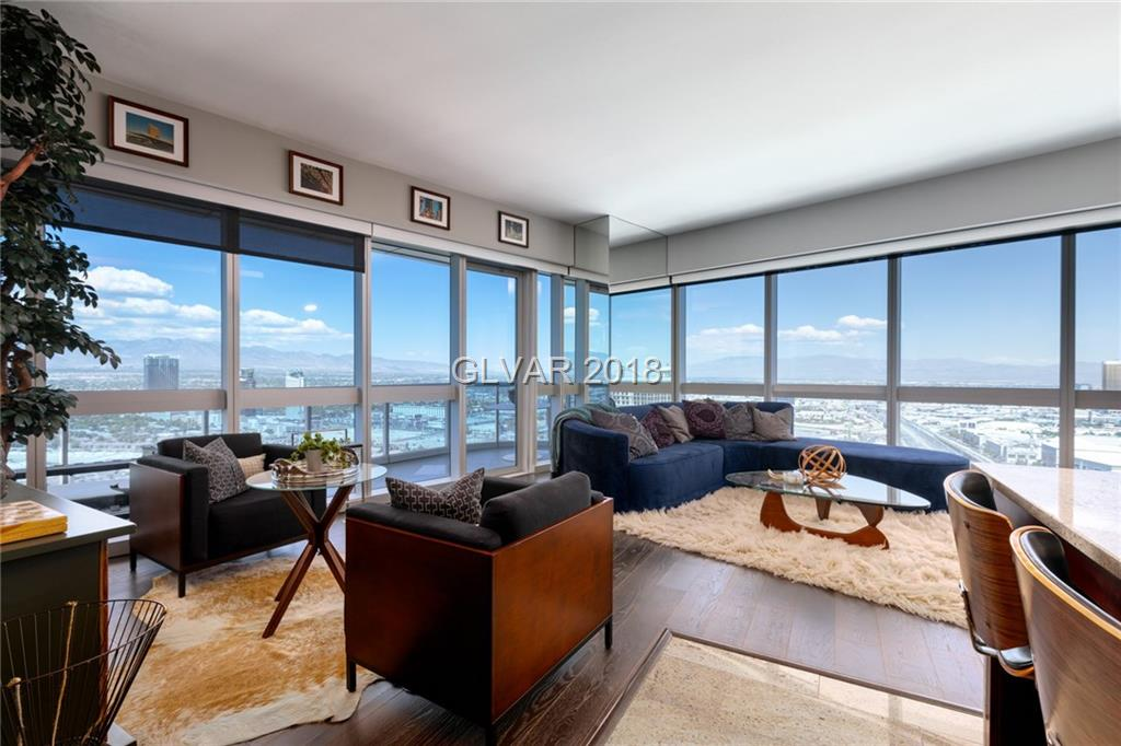 Fabulous one bedroom corner unit located in The Martin! Take in Strip and mountain views straight from your residence. Huge wrap round terrace with beautiful tile flooring. Open kitchen features stainless steel appliances and a custom backsplash. Other Features include: marble bathrooms, electric blinds, resort-style amenities and more!