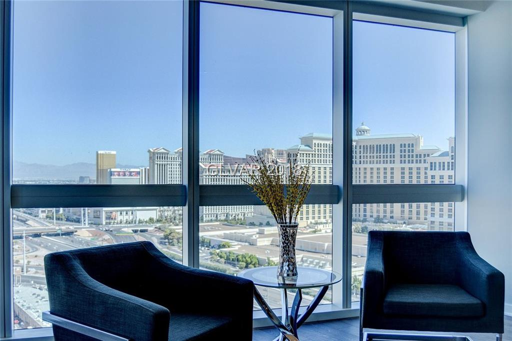 STUNNING 1 BR Corner Condo on the 23rd Floor at the Highly Sought After Martin High Rise! INCREDIBLE 270 Degree Views of the Strip, Mountains, & Stunning Desert Sunsets! HUGE Balcony! Fully Furnished! Luxurious Designer Custom Features:Media Ctr & Floating Headboard, Custom Tile Backsplash, Gorgeous Carpet, Blackout E Shades in Master! Spacious Ensuite Bath W/ Contemporary Carrara Marble. Full Service Bldg- Gym, Driver, Pool, Coffee Bar, & More!