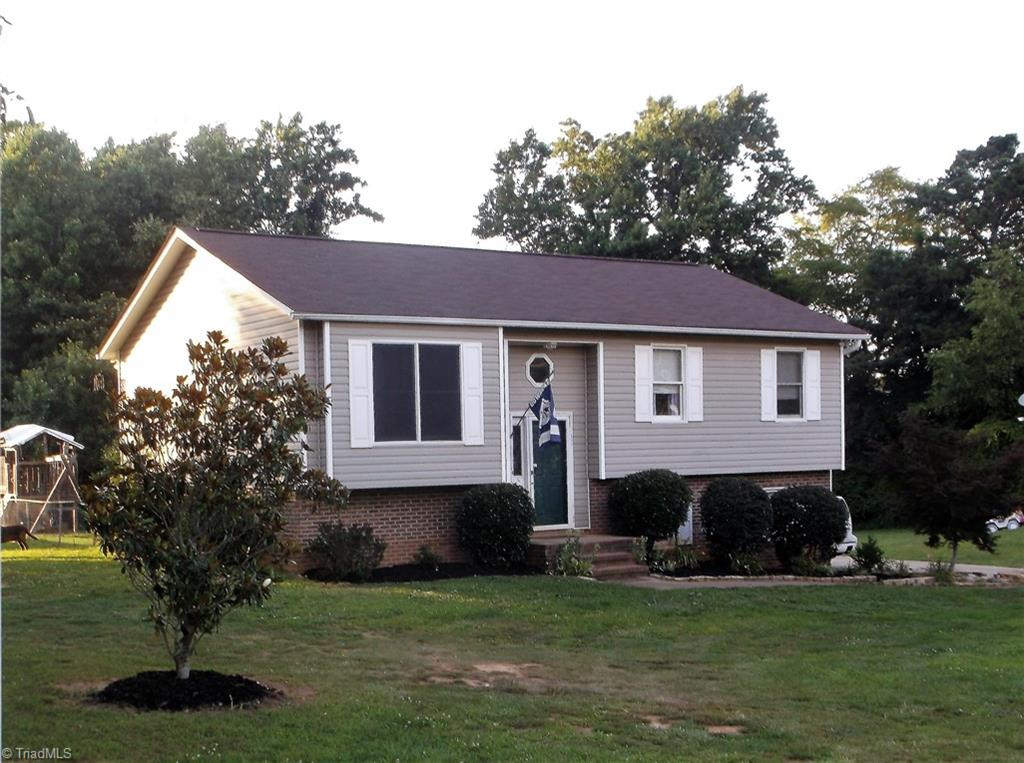 Cute split level w/Sauratown Mtn views in great location!! 3BR/2BA, kitchen has pantry, plenty of cabs & all appliances will stay, recent roof, shutters, gutters & spouts, laminate flooring in liv rm, hall & bdrms, mstr bdrm has private bath, full basement w/area framed out and floored for possible future expansion, 2 car basement garage, lg back multi-level deck for entertaining, custom built playhouse in fenced back yard, invisible fencing, pretty landscaping, paved driveway, Broker related to seller.