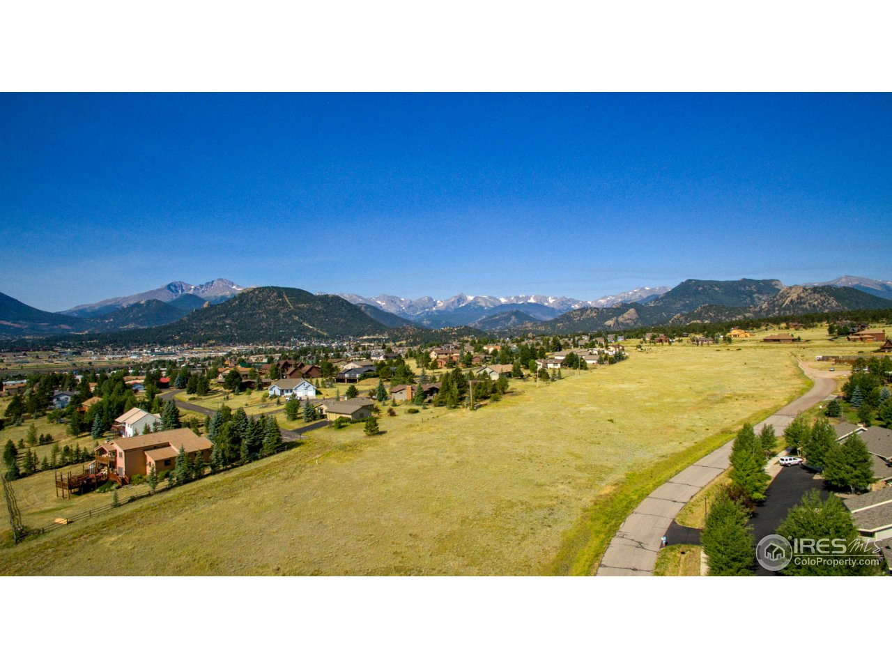 Rare offering on the North end of the Estes Valley! One of the last remaining parcels of this size close to town. 9.54 absolutely stunning acres on Wildfire Road.  Offers outstanding mountain views of Lumpy Ridge & the Continental Divide.  Calling all ranchers...18 horses allowed.  Or a developer's dream! Ability to subdivide into 14-15 single family lots, one single family dwelling per 1/2 acre. Call today to visit about this exciting opportunity, this won't last long!