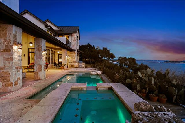 This gorgeous waterfront home, provides one of the best hill top views on main water, Lake Travis. It sits high above the award winning Northshore Marina within the private, Gated Estate section on the Peninsula. This home was designed and custom built by it's current owner, taking views, southern breezes, privacy, ideal family living in it's floor plan, quality in construction and finish out, all were provided in the completion of this special home. Walking distance to the Marina and all amenities!