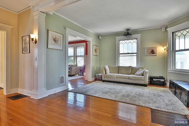 ...A gorgeous 6 bedrooms / 3 full bath Victorian located on a great East Hill street. Features beautiful architectural details, very bright, rich woodwork throughout, with built-in bookshelves, a butler's pantry, large closets, and high ceilings on every floor. the 2nd floor features a large master bedroom with master bath & WIC,2 additional bedrooms and a full bath and a view of the park across the street. The third floor features 3 large bedrooms and a full bath. The family room has a wood burning fireplace, central air with a built-in humidifier, a bonus sun porch, circular driveway, security system, and a fenced yard with patio and garden shed. Walking distance to transportation, library, restaurants, downtown shopping, and houses of worship. Move in Condition...A must see!!!