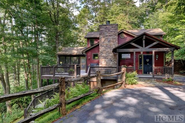 "This lakefront home has what everyone is looking for in a mountain lakefront home. COMPLETELY & BEAUTIFULLY remodeled in Arts & Crafts style. Exposed beams, dry stacked stone fireplace & drop dead gorgeous Heart pine floors adorn the great room. Kitchen boasts stainless appliances with Wolf gas range/oven. Kitchen cabinets are ""antiqued"" painted and give the home an English cottage feel. Corian countertops in kitchen & granite in baths. Four bedrooms for all of  your friends & family. Covered screen porch overlooking the gorgeous lake view. VERY gentle lot with pathway to your own private dock on quiet section of Lake Glenville. Lake side firepit to enjoy cool mountain evenings. Furnishings negotiable. This home is a must see and has the ""IT"" factor everyone is looking for. Don't miss this opportunity."