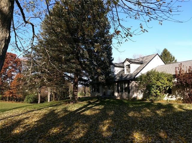 This stately Cape Cod sits on 8 beautiful rolling acres with a pond surrounded by boulders.  2 large out buildings.  Awesome open floor plan.  The home could be sold on less acreage at a reduced price.  Subject to Township approval of split.  Call listing agent for details. Exclude windmill.wreath,railroad signs Estate sale November 8, 9, 10
