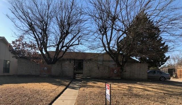 Nice family home situated on a spacious corner lot in desirable Lewisville neighborhood