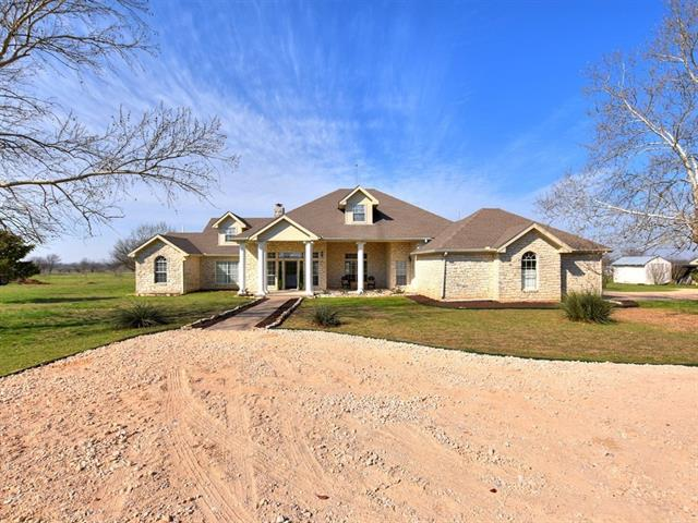 Generous windows brighten the home. A freshly painted neutral interior streamlines the space. Luxury vinyl plank floor throughout main living spaces. Sunny kitchen features cook-top in center island, double ovens, and stainless steel appliances. Master suite offers large walk-in closet, double vanities and separate tub and shower. Covered front porch with room for seating plus extended covered back porch with views of fruit trees. Partially fenced. Separate shop. 30 amp RV hook-up.